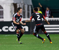 John Thorrington (8) of D.C. United celebrates a goal with teammate James Riley (2) during the game at RFK Stadium in Washington, DC.  D.C. United defeated Real Salt Lake, 1-0.