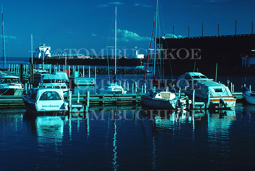 Presque Isle Marina, Marquette, Michigan, with the M/V H Lee White approaches the LS&I ore dock in the background.