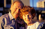 Older couple portrait on downtown street at sunset