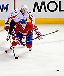 10 February 2010: Montreal Canadiens' left wing forward Sergei Kostitsyn is pursued by defenseman Jeff Schultz of the Washington Capitals at the Bell Centre in Montreal, Quebec, Canada. The Canadiens defeated the Capitals 6-5 in sudden death overtime, ending Washington's team-record winning streak at 14 games. Mandatory Credit: Ed Wolfstein Photo
