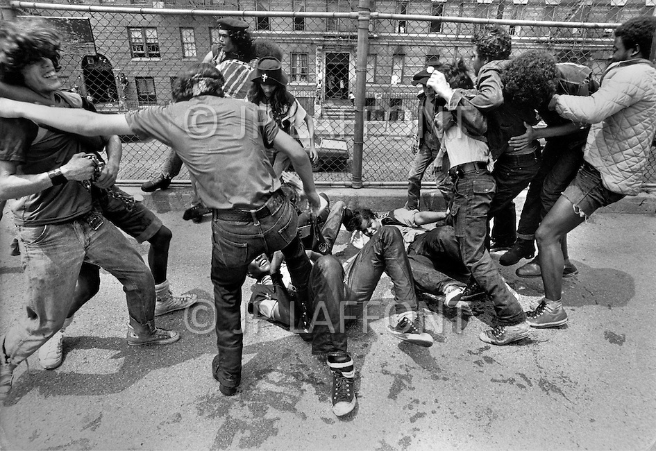 """New York, NY July 20th 1972. New York street gang """"Savage Skulls"""". The trademark of the primarily Puerto Rican gang was a sleeveless denim jacket with a skull and crossbones design on the back. Based in the Hunts Point area of the South Bronx, the gang declared war on the drug dealers that operated in the area. Running battles were frequent with rival gangs """"Seven Immortals"""" and """"Savage Nomads"""". - members of the """"Dirty Dozen"""" gang"""