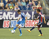 Philadelphia Union midfielder Michael Farfan (21) clears the ball.  In a Major League Soccer (MLS) match, the New England Revolution (dark blue) defeated Philadelphia Union (light blue), 5-1, at Gillette Stadium on August 25, 2013.