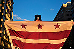 A supporter waves a flag in support of Washington DC statehood at the Second Inauguration of President Barack Obama on Jan. 21, 2013.