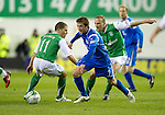 Hibs v St Johnstone....27.11.10  .Chris Millar gets between John Rankin and Edwin De Graaf.Picture by Graeme Hart..Copyright Perthshire Picture Agency.Tel: 01738 623350  Mobile: 07990 594431