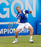 Dimitry Tursunov (RUS) against Xavier Malisse (BEL) in the first round of the men's singles. Malisse won the first set 6-2...Tennis - ATP World Tour - AEGON Championships - Queen's Club - London - Day 2 - Tues 08 Jun 2010..© AMN Images - Level 1, Barry House, 20-22 Worple Road, London, SW19 4DH.Tel - +44 (0) 208 947 0100.email - mfrey@advantagemedianet.com. www.photoshelter.com/c/amnimages.
