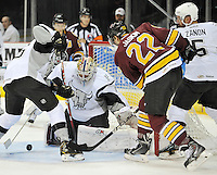 San Antonio Rampage goaltender Dov Grumet-Morris makes a save on Chicago Wolves' Dmitrij Jaskin during the first period of an AHL hockey game, Friday, Oct. 4, 2013, in San Antonio. Chicago won 2-1. (Darren Abate/M3D14.com)