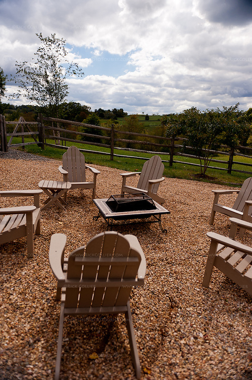 Comfortable wooden chairs make a nice group arrangement around a fire pit near the patio at Vintage Ridge Vineyards.