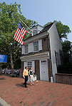 Betsy Ross House, couple passing, mod rel..Philadelphia, Pennsylvania, PA USA.  Photo copyright Lee Foster, 510-549-2202, lee@fostertravel.com, www.fostertravel.com. Photo 276-30447