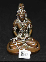 BNPS.co.uk (01202 558833)<br /> Pic: HAldridge/BNPS<br /> <br /> The Tibetan gilt copper buddha deity that were left at home.<br /> <br /> A man who took an old silver teapot along to TV's Flog It is celebrating today after it led to a record 140,000 pounds sale.<br /> <br /> Experts on the BBC show valued the item, that originated from the Far East, at 120 pounds, prompting the owner to reveal he had five other heirlooms at home.<br /> <br /> After digging the relics out he sold them at auction for the six figure sum, setting a record for the highest amount ever achieved on the popular programme.<br /> <br /> The show is very much like the Antiques Roadshow except that people go on to sell their treasures at auction which is also filmed by the Beeb.<br /> <br /> The unnamed owner took the 12ins tall teapot along to a valuation day held last month at Longleat House, Wilts.
