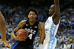 17 February 2016: Duke's Brandon Ingram (14) drives against North Carolina's Theo Pinson (1). The University of North Carolina Tar Heels hosted the Duke University Blue Devils at the Dean E. Smith Center in Chapel Hill, North Carolina in a 2015-16 NCAA Division I Men's Basketball game.