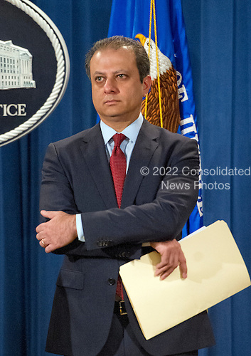 United States Attorney Preet Bharara of the Southern District of New York looks on as US Attorney General Loretta E. Lynch makes opening remarks during a press conference at the Department of Justice in Washington, DC on Thursday, March 24, 2016.  They announced criminal charges against seven individuals working on behalf of the Iranian government for conducting cyber attacks against the US financial sector and the Bowman Dam in Rye, NY.<br /> Credit: Ron Sachs / CNP<br /> (RESTRICTION: NO New York or New Jersey Newspapers or newspapers within a 75 mile radius of New York City)