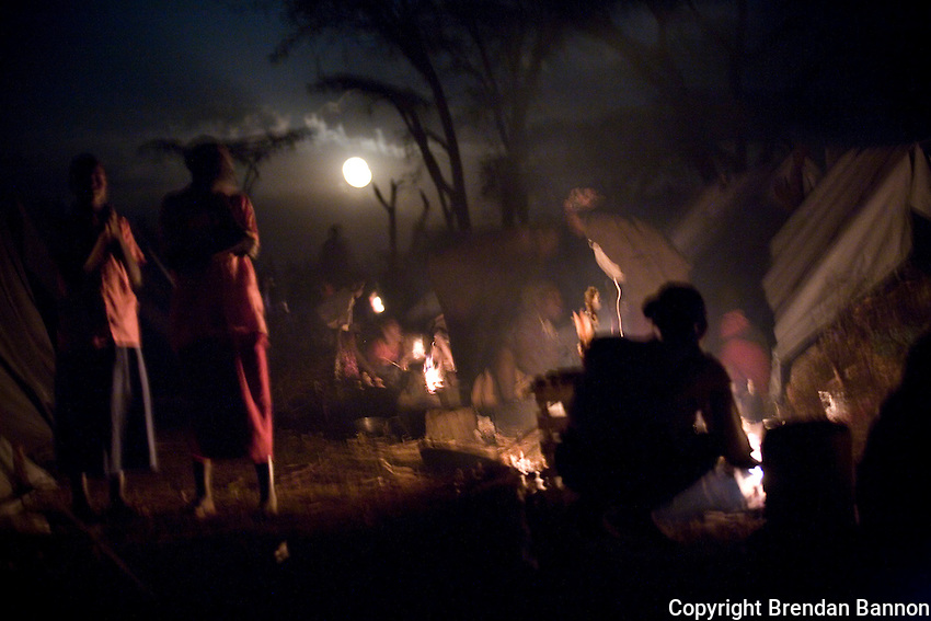Women cooking an evening meal in Endebess IDP camp in Kenya following post-electin violence in 2008..