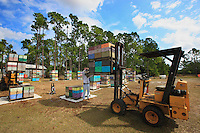 At Bob Harvey's apiary in West Palm Beach, Florida: preparation of the hives and an inspection to detect the presences of ants on the hive's pallets. Insecticide was sprayed on the ground fifteen day ago and the pallets cleaned with a high-pressure water cleaner.