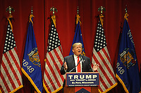 """Republican presidential frontrunner Donald Trump talks to a crowd of mostly students in the Webster Theater at St. Norbert College in De Pere, Wisconsin on March 30, 2016.  In a divergence from the usual fodder of political campaign stump speeches, Trump spoke about success, at one point remarking, """"Be around people less successful than you, you will be respected."""""""