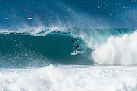 PIPELINE, Oahu, Hawaii (Tuesday, December 10, 2013) Joel Parkinson (AUS).- The 2013 Billabong Pipe Masters in Memory of Andy Irons resumed today in six foot (2 metre) barrels and there was no shortage of drama in the ASP World Title race between Mick Fanning (AUS), 32, and Kelly Slater (USA), 41. There was also a shift in the Vans Triple Crown of Surfing Rankings as well as qualification developments for the 2014 WCT.<br /> <br /> The Billabong Pipe Masters represents the pinnacle of the 2013 ASP World Championship Tour, deciding the ASP World Title, Vans Triple Crown of Surfing, and final slots for 2014 ASP WCT qualification.<br /> <br /> Mick Fanning, two-time ASP World Champion and current No. 1, dominated his Round 3 clash with wildcard Kaimana Jaquias (HAW), 20, but unexpectedly erred in his three-man Round 4 heat against John John Florence (HAW), 21, and Nat Young (USA), 22. A last minute paddle battle with heat leader Florence in the closing seconds of the match took him from second to third and now pits him against one of the best Pipeline surfers in the world: C.J. Hobgood (USA), 34, in Round 5. Meanwhile, Slater skips Round 5 and heads straight to the Quarterfinals after his Round 4 win.<br /> <br /> Clearly disappointed with his misstep, Fanning couldn&rsquo;t leave the beach fast enough and wasn&rsquo;t prepared to talk about how this affects his approach to the final day of competition.<br /> <br /> Kelly Slater was electric in his bid for a historic 12th ASP World Title, earning the high heat-totals of both Round 3 and 4. Slater tore past Mitch Crews (AUS), 23, with a 17.66 out of 20 heat total for incredible Pipeline and Backdoor barrels and backed up the performance with a 17.50 out of 20 in Round 4.<br /> Photo: joliphotos.com