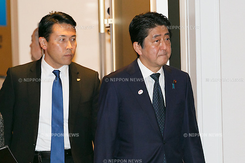 Japanese Prime Minister Shinzo Abe attends the World Assembly for Women : WAW! 2016 on December 13, 2016, Tokyo, Japan. Female leaders from politics, business, sports and society are attending WAW! 2016 to discuss the roles of women in their countries and affiliations. Japan is trying to increase the participation of women in work and Abe's administration set a goal of increasing the share of women in management roles to 30 percent by 2020. WAW! 2016 is being held from December 13 to 14 at the Grand Prince Hotel New Takanawa in Tokyo. (Photo by Rodrigo Reyes Marin/AFLO)
