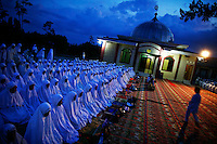"""Muslim worshippers gather for an evening collective prayer and zikr outside a mosque in Banda Aceh December 5, 2012. Indonesia is the world's most populous Muslim nation, but nowhere is the faith more strictly interpreted than in Aceh, sometimes referred to as the """"verandah of Mecca"""" because it was one of the first parts of the archipelago to turn to Islam. Aceh is Indonesia's only province to have implemented Sharia or Islamic laws.    REUTERS/Damir Sagolj (INDONESIA)"""