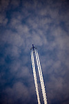 Airliner with contrails, about the Pyrenees, France.