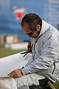 Pictures of Nico Berenger. Shown here repairing the spinnaker ..Credit: Lloyd Images
