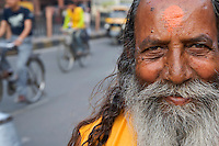 A Sadu Holy man in jaipur City Street scene and Market area, Rajasthan India, also called the pink City