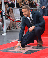Actor Ryan Reynolds at the Hollywood Walk of Fame Star Ceremony honoring actor Ryan Reynolds.<br /> Los Angeles, CA. <br /> December 15, 2016<br /> Picture: Paul Smith/Featureflash/SilverHub 0208 004 5359/ 07711 972644 Editors@silverhubmedia.com