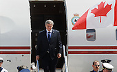 Prime Minister Stephen Harper of Canada arrives with his delegation April 12, 2010 at Andrews Air Force Base in Maryland. Leaders from around the world including nuclear powers are meeting in Washington this week for a two-day nuclear security summit. .Credit: Olivier Douliery / Pool via CNP