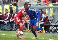 Toronto, Ontario - April 12, 2014: Colorado Rapids forward Edson Buddle #9 and Toronto FC defender Mark Bloom #28 in action during the 2nd half in a game between the Colorado Rapids and Toronto FC at BMO Field in Toronto.<br /> Colorado Rapids won 1-0.