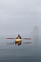 WA09197-00...WASHINGTON -  Luke Johansen kayak fishing on a foggy morning in the Strait of Juan de Fuca.        (MR# J9)