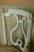 Detail of a lyre-backed chair in one of the bedrooms
