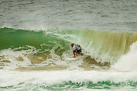 KIRRA, Queensland/Australia (Wednesday, March 13, 2013) - Kelly Slater (USA), 41, 11-time ASP World Champion and 2012 ASP World Runner-Up, has claimed the 2013 Quiksilver Pro Gold Coast in firing three-to-five foot (1 - 1.5 metre) barrels at Kirra over reigning ASP World Champion Joel Parkinson (AUS), 31, in front of a capacity crowd on the Gold Coast..The opening stop on the 2013 ASP World Championship Tour (WCT), the Quiksilver Gold Coast culminated in fine fashion today with a tube-riding shootout between two of the sport's greatest champions..Slater and Parkinson opened their 40-minute Final bout with a rapid-fire exchange of tube-riding displays, vaulting the lead back and forth before Slater nailed a 9.93 for an incredibly-deep barrel punctuated by a full-velocity forehand gaff..Today win marks Slater's 52nd elite tour victory of his career, but the iconic Floridian admits that it's a long season ahead in terms of the hunt for the 2013 ASP World Title...Parkinson looked unbeatable on the final day of the event, collecting a Perfect 10 in his morning Semifinal before posting an excellent 17.47 in his Final against Slater. However, the impressive scoreline would prove insufficient against the American's onslaught and the reigning ASP World Champion would post a Runner-Up finish in the opening event of the year..Mick Fanning (AUS), 31, two-time ASP World Champion (2007, 2009), went down in a barrel shootout this morning with Slater. Despite opening up with an impressive scoreline and an early lead, the Kirra local would ultimately fall to Slater in the dying moments of the heat - 18.60 to 19.37..Fanning collects an Equal 3rd place finish in the opening event of the season..Michel Bourez (PYF), 27, opened up this morning's action with a Semifinal bout against Parkinson. Despite being universally-celebrated as one of the most powerful surfers throughout the event, the Tahitian found himself at odds this morning after the Australian's quick start to their clash...Ph