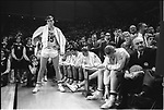 19 MAR 1966:  Kentucky coach Adolph Rupp (with basketball) and his players in the 1966 championship game watch as Texas Western (UTEP) receives the championship trophy. Kentucky lost 65-72 after Texas Western's Bobby Joe Hill had successive steals to turn the game around. .Photo:  &copy; Rich Clarkson / NCAA Photos