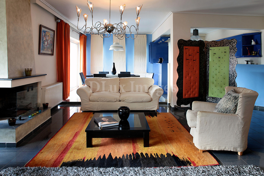 modern colorful living room<br /> <br /> Giorgos Panopoulos lives in a contemporary house in Athens, Greece, decorated with his own personal taste and style mixing old and modern furniture and ornaments.