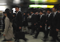 Businessmen rush through an underground walkway in Shinjuku Station, Tokyo, Japan.  With up to 4 million passengers passing through it every day, Shinjuku station, Tokyo, Japan, is the busiest train station in the world. The station was used by an average of 3.64 million people per day.  That&rsquo;s 1.3 billion a year.  Or a fifth of humanity. Shinjuku has 36 platforms, and connects 12 different subway and railway lines.  Morning rush hour is pandemonium with all trains 200% full. <br /> <br /> Photo by Richard jones / sinopix