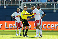Thiierry Henry (14) Red Bulls forward shakes hands with referee Kevin Stott after being shown a red card for a foul on Sporting KC's Roger Espinoza... Sporting Kansas City defeated New York Red Bulls 2-1 at LIVESTRONG Sporting Park, Kansas City, Kansas.