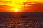 Silhouetted yacht against the setting sun,Tenerife, Canary Islands, Spain