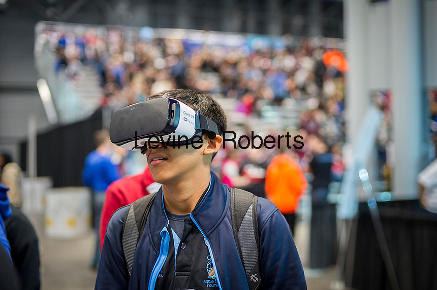 A participant uses a Samsung Gear VR virtual reality device a the Two Sigma Investments booth at a Career Expo held at the FIRST Robotics NYC Championship at the Jacob Javits Convention Center in New York on Sunday, March 13, 2016. The expo enables participants to speak with companies and professional organizations giving a real-world look into science and technology as used in the business world and their career opportunities. (© Richard B. Levine)