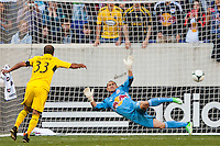 Federico Higuain (33) of the Columbus Crew beats New York Red Bulls goalkeeper Luis Robles (31) on a penalty kick. The New York Red Bulls and the Columbus Crew played to a 2-2 tie during a Major League Soccer (MLS) match at Red Bull Arena in Harrison, NJ, on May 26, 2013.