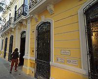 Woman entering the Casa Frederick Catherwood in Merida, Yucatan, Mexico