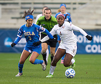 Caprice Dydasco (3) of UCLA closes in on Jamia Fields (4) of Florida State during the NCAA Women's College Cup finals at WakeMed Soccer Park in Cary, NC.  UCLA defeated Florida State, 1-0, in overtime.
