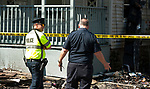 WATERBURY,  CT-051817JS05- Police and fire investigators were on the scene early Thursday to assess the damage the day after a fire destroyed four homes on Lounsbury Street  in Waterbury.  <br /> Jim Shannon Republican-American