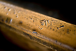 Photo shows an engraving on a handrail inside the Korakukan theate, Japan's oldest extant wooden playhouse in Kosaka, Akita Prefecture Japan on 19 Dec. 2012. Photographer: Robert Gilhooly