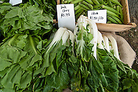 Bok Choy and Okra for sale at a farmers' market.