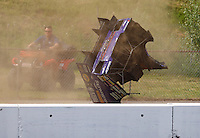 Jun 4, 2016; Epping , NH, USA; Body work from the car of NHRA funny car driver Jack Beckman flies over the wall after an engine explosion during qualifying for the New England Nationals at New England Dragway. Beckman was uninjured. Mandatory Credit: Mark J. Rebilas-USA TODAY Sports