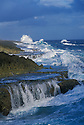 Waves breaking on  rocky coastline at Shete Boka National Park at Boka Wadomi Natural Bridge; Curaçao, Netherlands Antilles.
