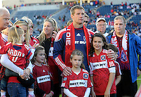 Chicago Fire forward Brian McBride (20) smiles waits with his family for a tribute by the Fire.  This game was McBride's last home game for the Fire.  The Chicago Fire tied DC United 0-0 at Toyota Park in Bridgeview, IL on Oct. 16, 2010.