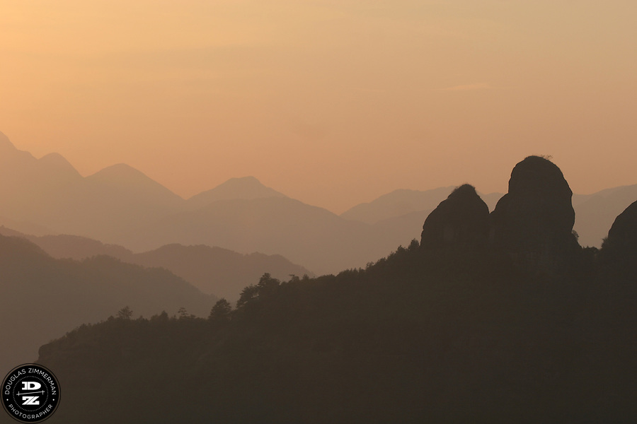 The late afternoon sun shines down on Heavenly Peak and the Wuyi Shan scenic area in Wuyi Shan, China.  Wuyi Shan has some of the most spectacular natural beauty in Fujian province.  Photograph by Douglas ZImmerman.