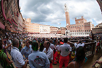 The medical service awaits for the parade and race of the Palio di Siena to start