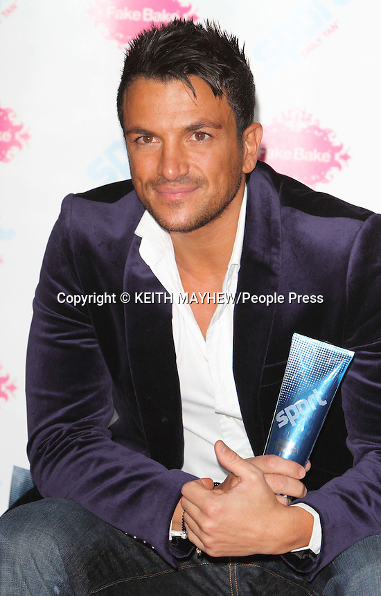 London - Peter Andre at launch photocall for Fake Bake's 'Sport Daily' at the Rose Club, London - April 17th 2012..Photo by Keith Mayhew