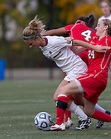 Boston College midfielder Kristen Mewis (19) fails to beat two defenders. Boston College defeated Marist College, 6-1, in NCAA tournament play at Newton Campus Field, November 13, 2011.