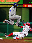 21 June 2010: Kansas City Royals shortstop Yuniesky Betancourt leaps over a sliding Nyjer Morgan in a double play against the Washington Nationals at Nationals Park in Washington, DC. The Nationals edged out the Royals 2-1 in the first game of their 3-game interleague series, snapping a 6-game losing streak. Mandatory Credit: Ed Wolfstein Photo